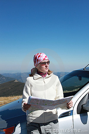 Woman with map on a road trip