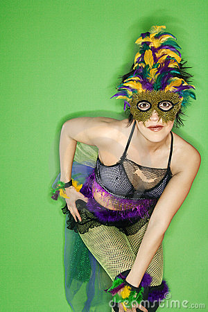 Woman in Mardi Gras costume.