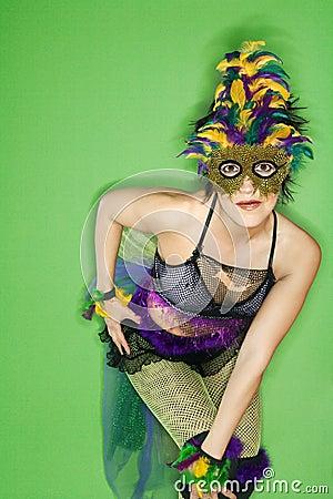 Woman in Mardi Gras costume.