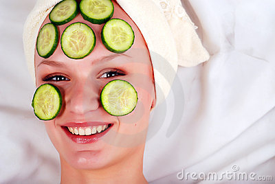 Woman in mask from cucumber