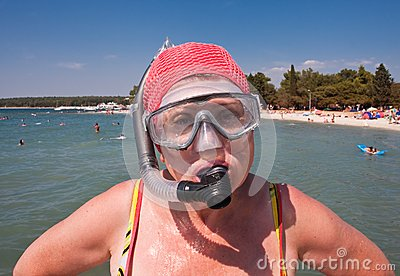 Woman with a mask and snorkel