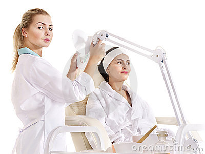 Woman on massage table in beauty spa.