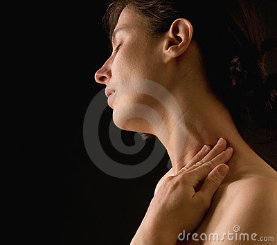 Woman massaging her neck