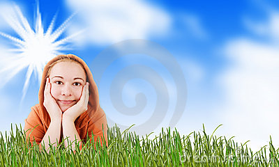 Woman on a meadow in grass