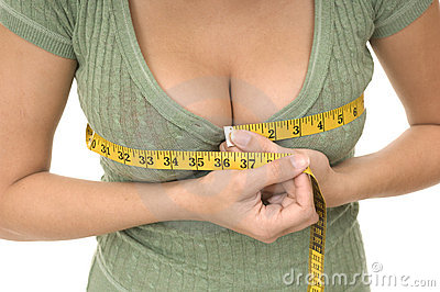 Woman measuring bust line
