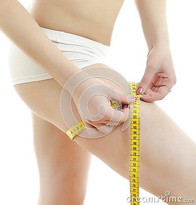 Woman measuring her leg.