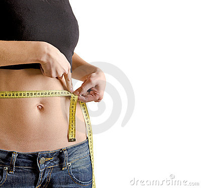Woman measuring waistline with a tape