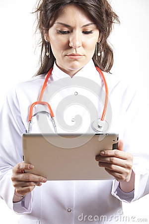 Woman Medical doctor using tablet