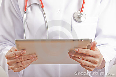 Woman Medical doctor using tablet pc