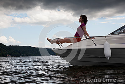 Woman meditate on bow of cutter
