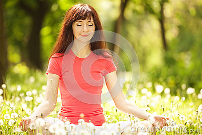 Woman meditate in the park