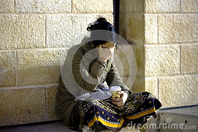 Woman meditates before Wall of Weeping Editorial Photo