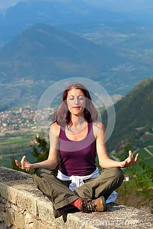 Woman Meditating In The Alps.