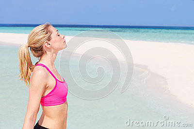 Woman Meditating On Beautiful Beach