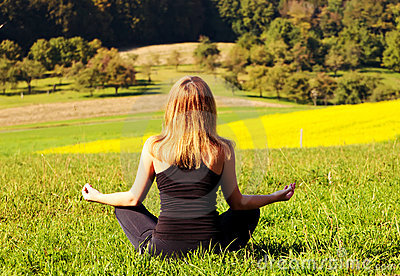 Woman meditating in the field