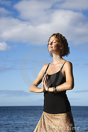 Woman Meditating By Ocean. Stock Photos - Image: 4411693