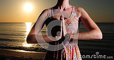 Woman meditating or praying