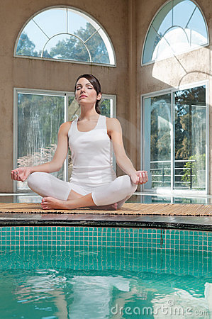 Woman meditating sitting in lotus position