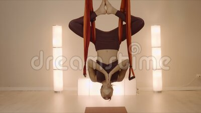 woman meditating in inverted butterfly pose at studio