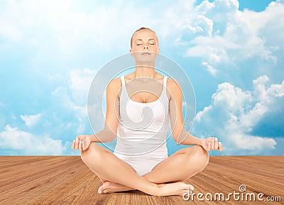 woman meditating in yoga lotus pose stock photo  image