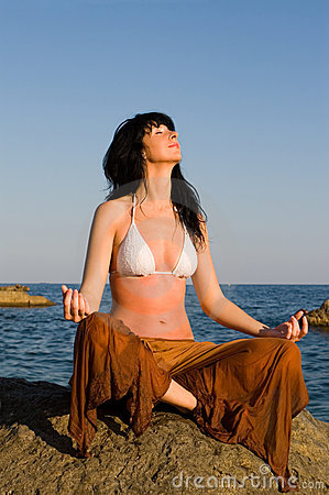 Woman meditation in the beach