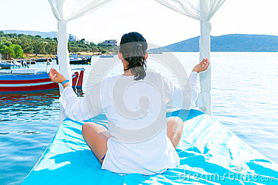 Woman at meditation  on the sea coast,