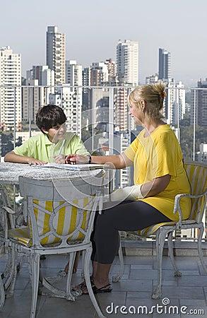 Woman Mentoring Boy - Vertical