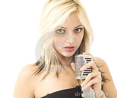 Woman and microphone with wide eyes