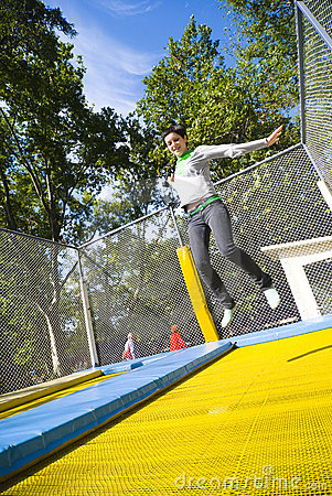 Woman in mid-air on trampoline