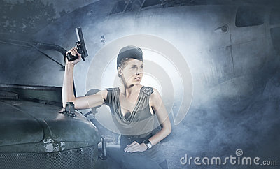 A woman in military clothes on a foggy background