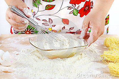 Woman mixing dough