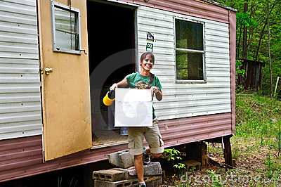 Woman at a Mobile Home
