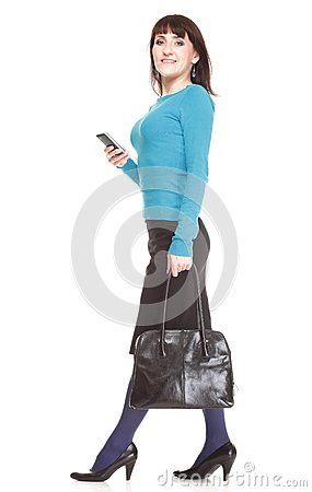Woman with mobile phone holding a bag
