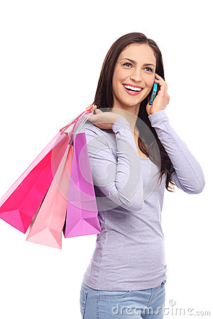 Woman with mobile phone and shopping bags