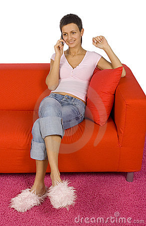 Woman with mobile on the sofa