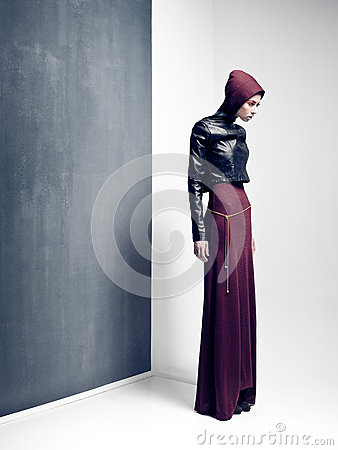Woman model posing very dramatic in an minimal studio setup