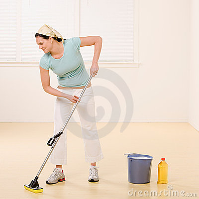 Woman mopping floor with cleaner