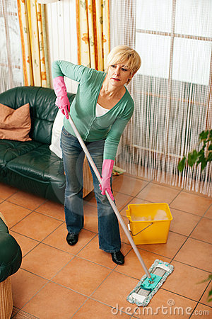 Woman mopping the floor in her home