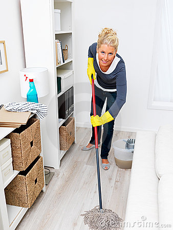 Woman mopping living room floor