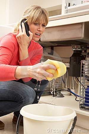 Woman Mopping Up Leaking Sink