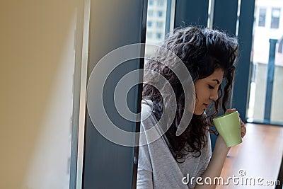 Woman with morning coffee mug