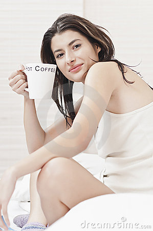 Woman in the morning with a cup of coffe