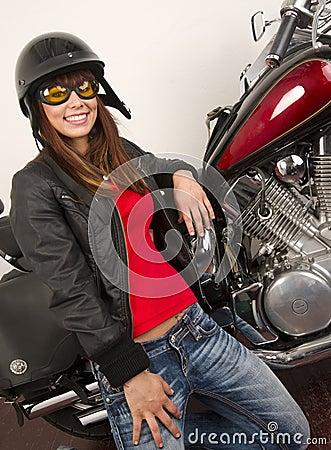 Woman beside Motorcycle sexy huge smile
