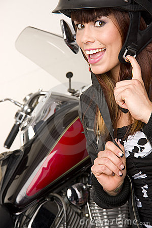 Woman beside Motorcycle putting on gear