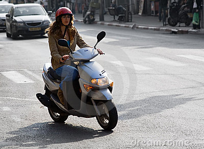 Woman On Motor Bike