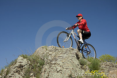 The woman on mountain bicycle