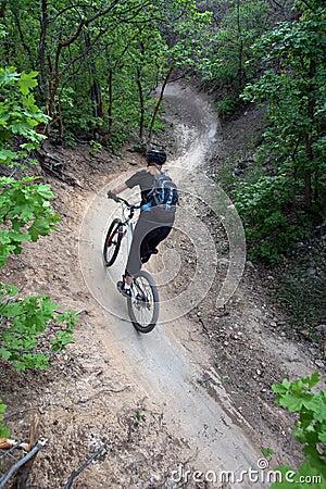 Woman mountain biker / s-curve