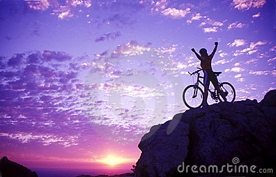 Woman on a mountaintop with bike