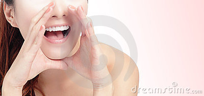 Woman mouth whispering with pink background