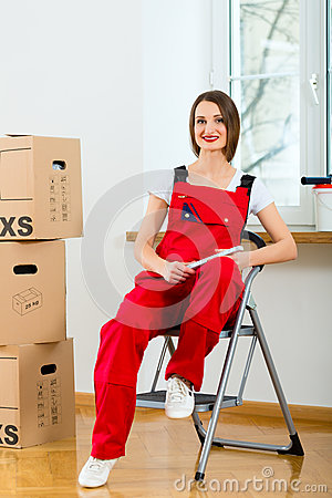 Woman with moving box in her house